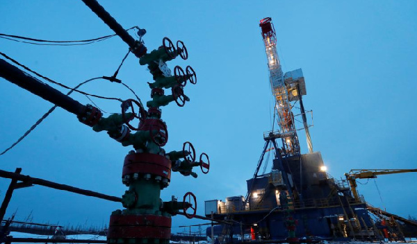 A view shows a well head and a drilling rig in the Yarakta Oil Field, owned by Irkutsk Oil Company