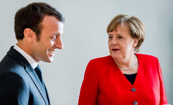 French President Emmanuel Macron has pledged support for German Chancellor Angela Merkel