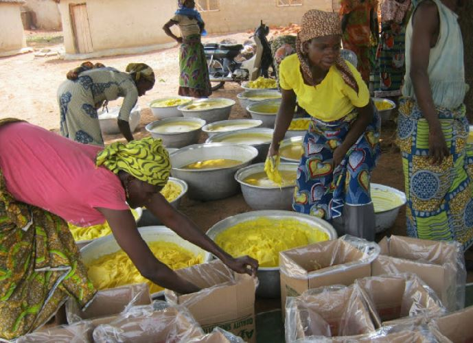 Shea butter producers making the cream