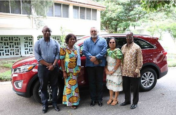 Rawlings poses with ex-minister