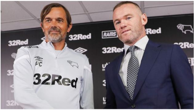 Wayne Rooney shakes hands with Derby County manager Phillip Cocu