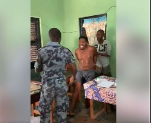 Suspect being flogged mercilessly by two men