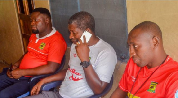 Maxwell Konadu (middle) at the residence of injured Kotoko fan Augustine Opoku