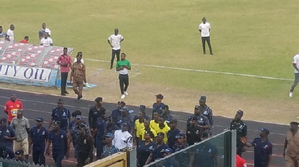 Police escorting referees at the Baba Yara Sports Stadium