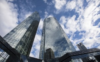 The Deutsche Bank AG twin tower headquarters stand in the financial district in Frankfurt.