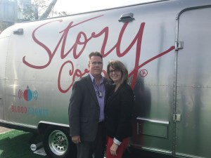 Michael and Robin Tuohy pose in front of the StoryCorps bus at ASH 2016.