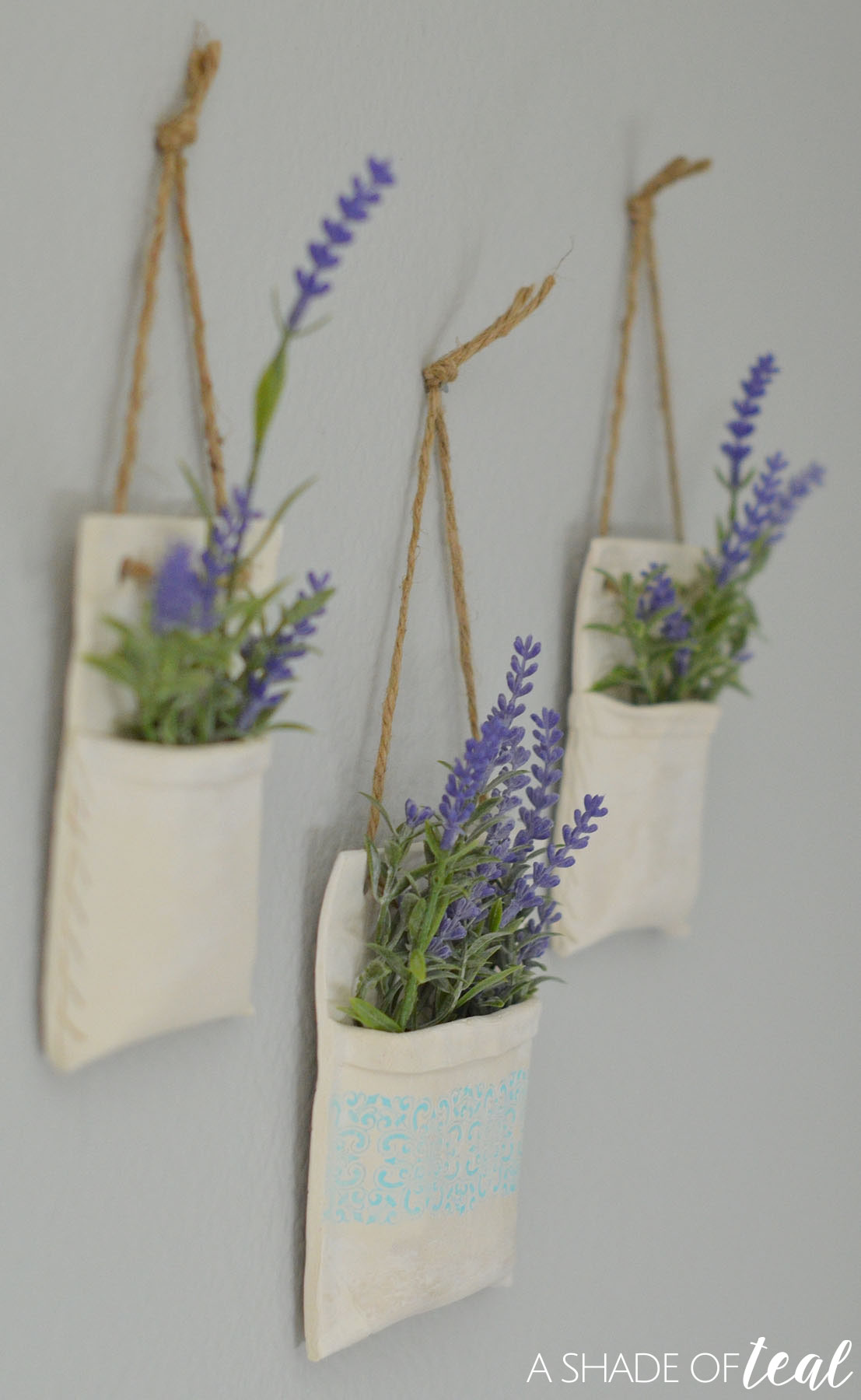 How to make clay hanging flower vases create share challenge i added faux lavender to mine its my favorite for spring i currently have these hanging in my office but they might find a new home soon reviewsmspy
