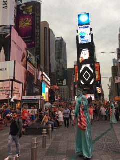 After work, sitting down amidst the sea of people and activities at Time Square