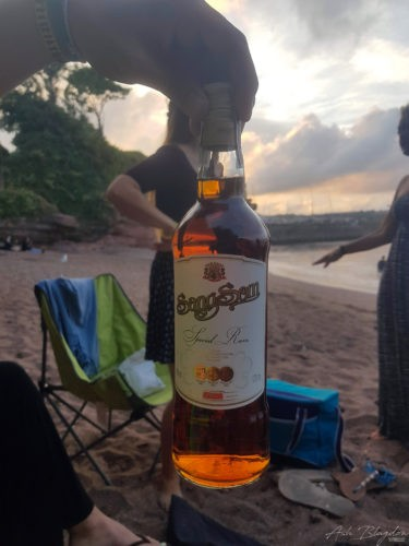 Bottle of rum at the beach
