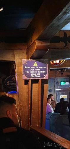 theme park ride sign post