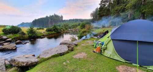 Tent set up next to river
