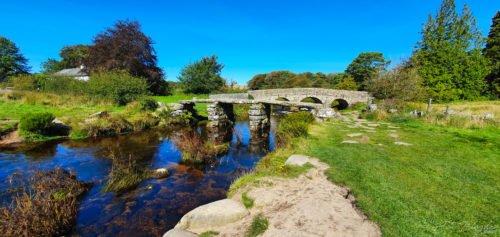 a medieval bridge over a river