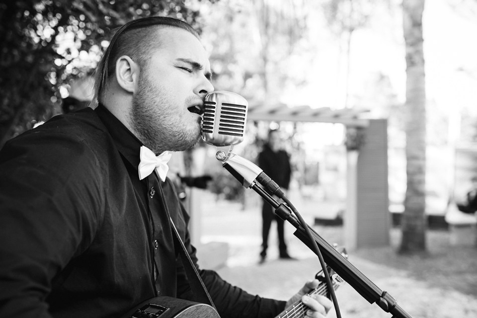 backyard vintage carnival wedding, cass rife, solo guitarist at a wedding