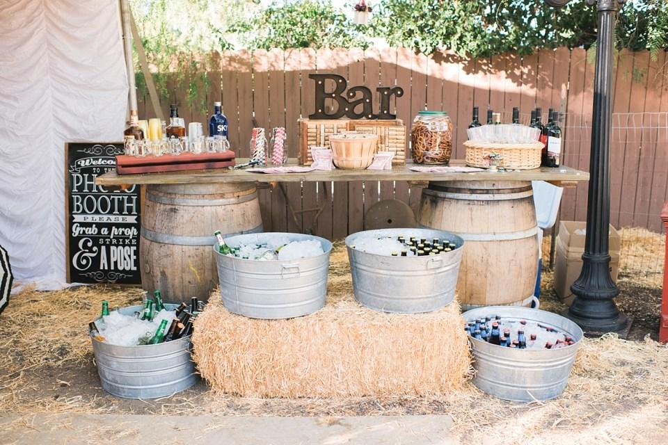 backyard vintage carnival wedding, circus wedding decor, carnival wedding decor, vintage wedding decor, DIY wedding, serve yourself bar at wedding