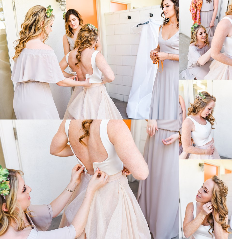bridesmaids assisting bride get dressed