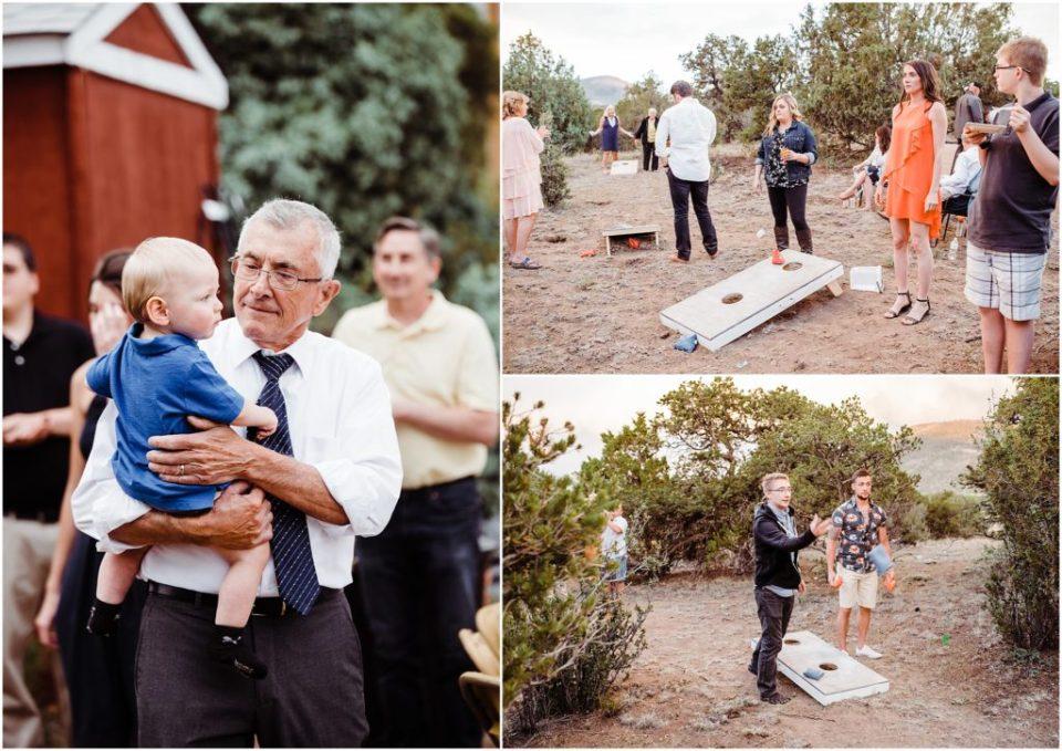 guests playing yard game at backyard wedding