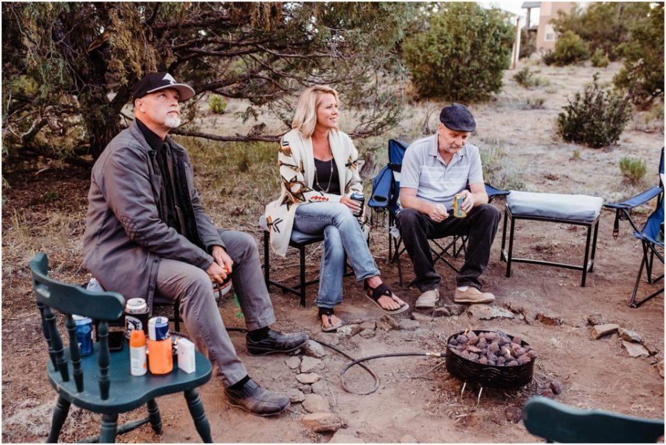 wedding guests around campfire