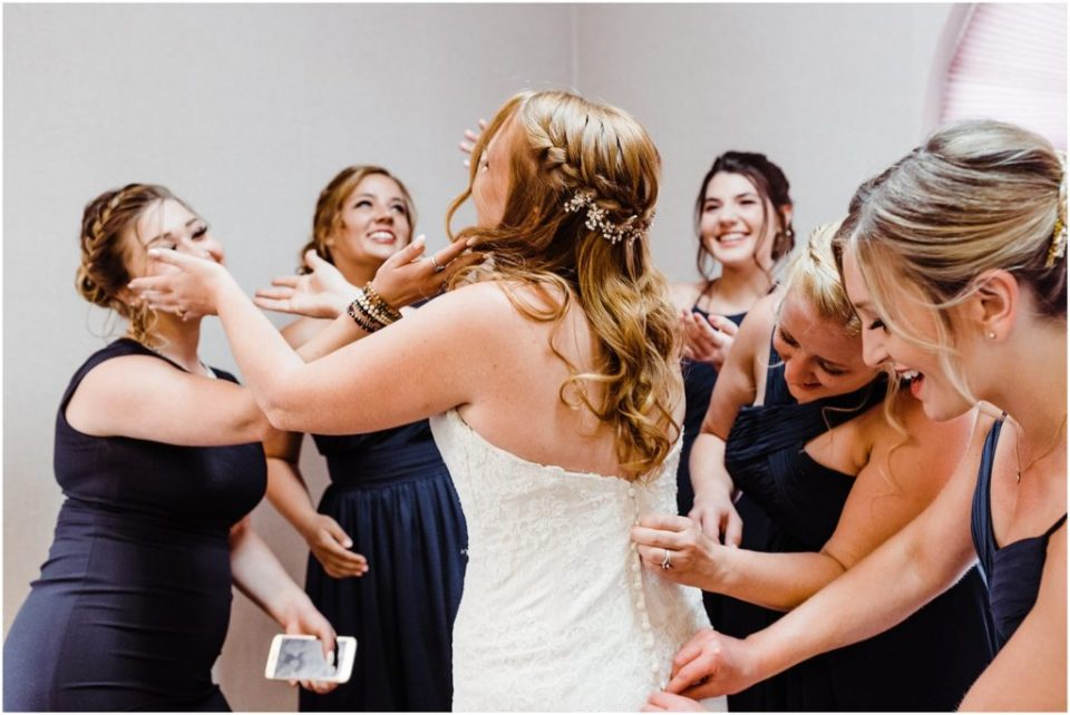 bride getting dressed in conference room