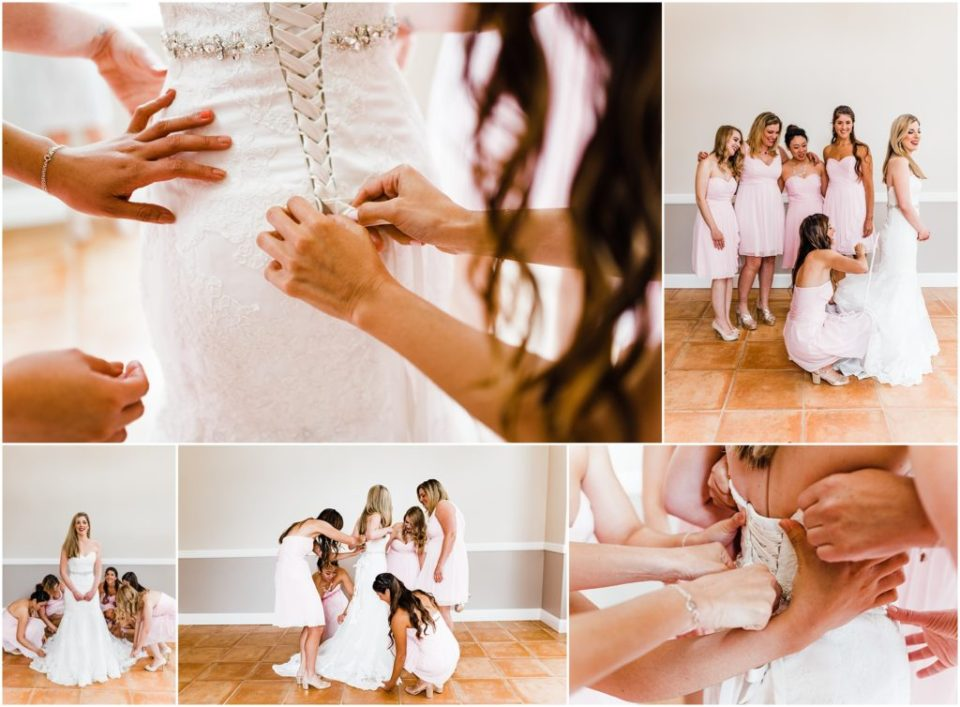bride getting dressed with her bridesmaids