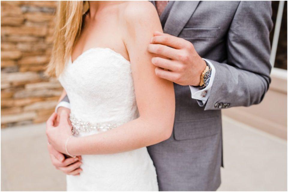 groom gently rubbing brides arm