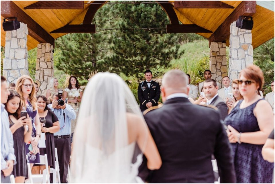 groom crying when he sees bride walking down the aisle