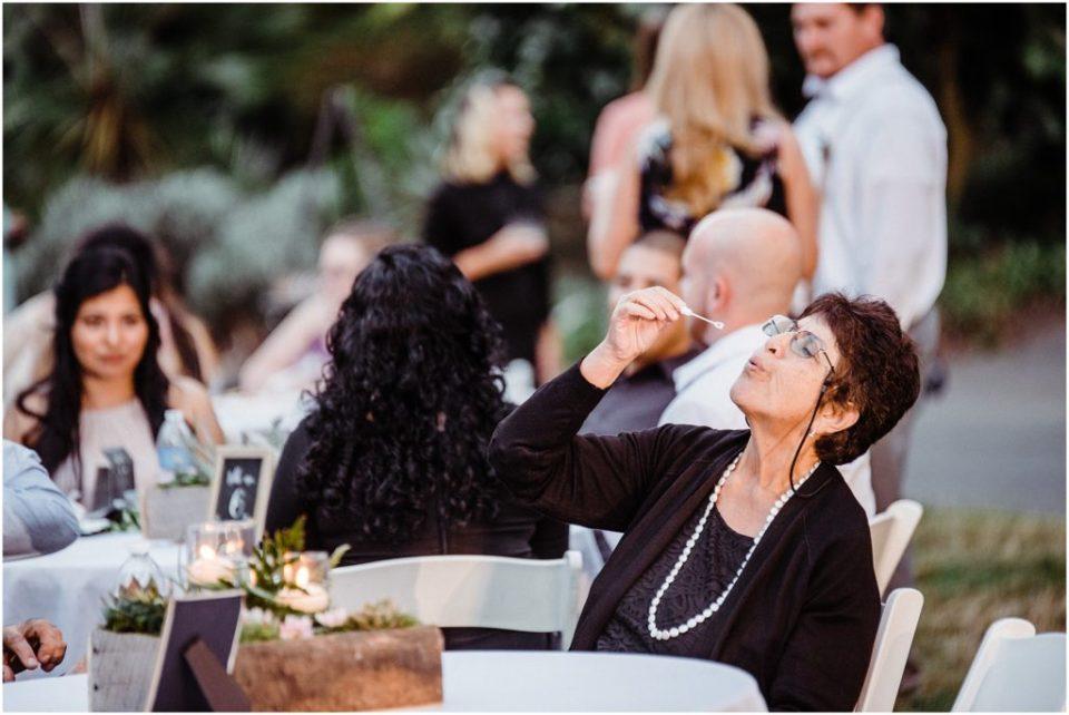 san diego botanic garden wedding reception blowing bubbles