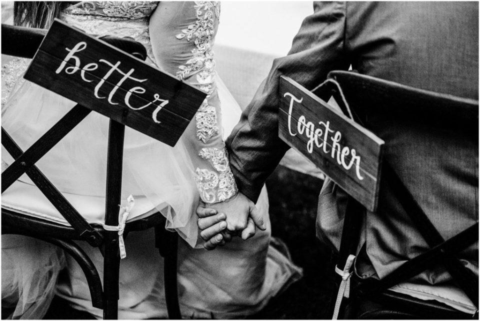 better together sign holding hands