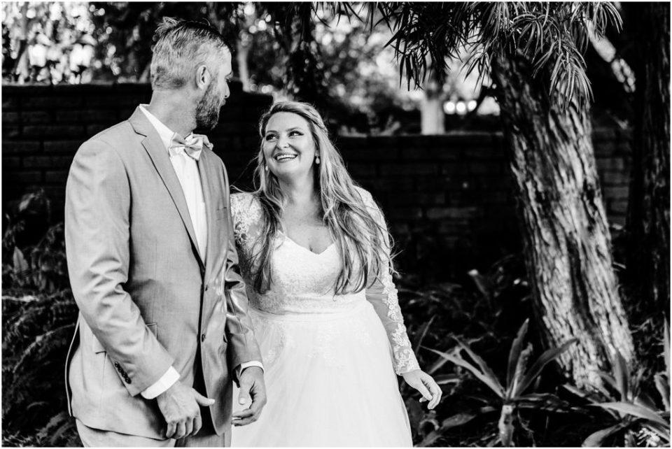 bride beaming at her groom