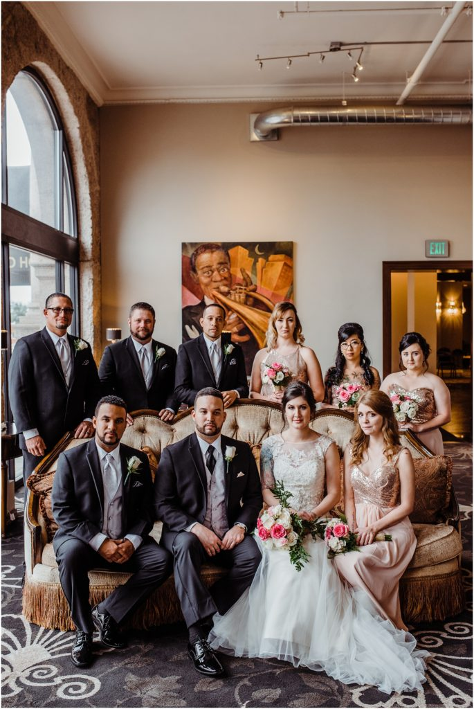 wedding party pictures in the mining exchange hotel lobby