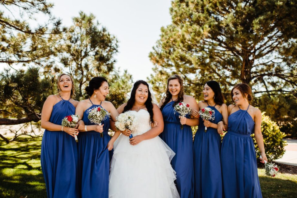 bride and bridesmaid in blue dress