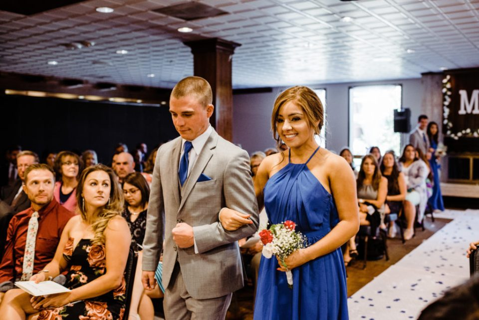 indoor wedding ceremony at the club on peterson air force base