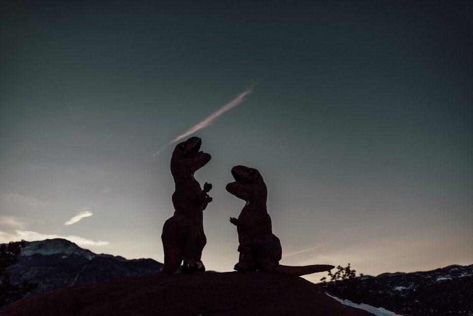 engagement photos in dinosaur costumes