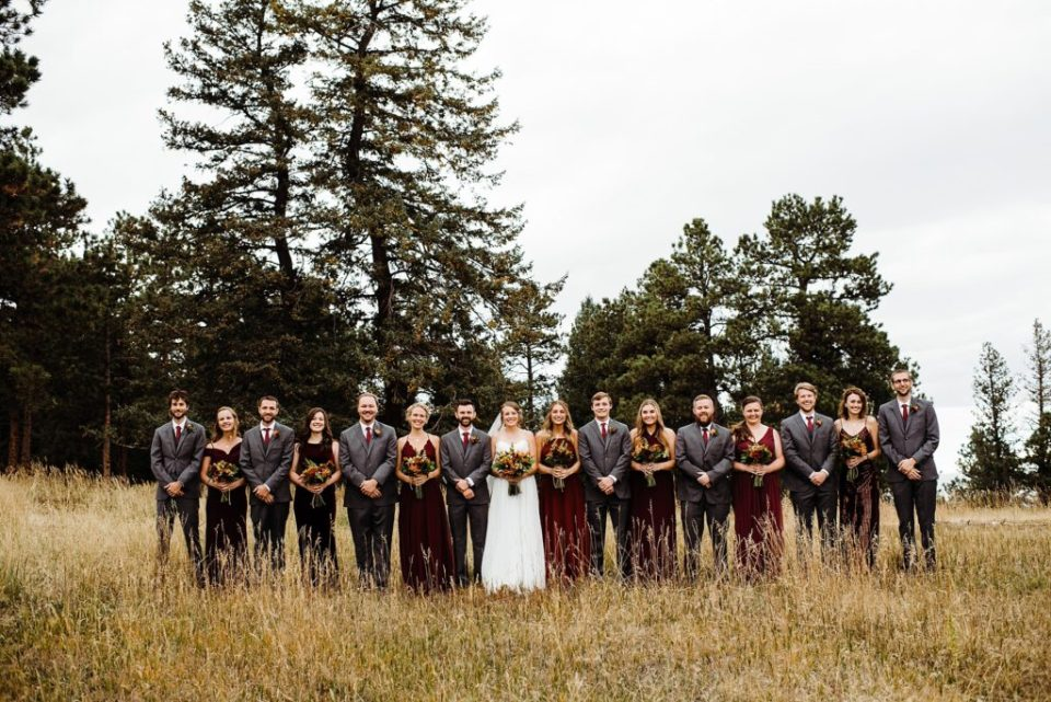 large wedding party in maroon and gray