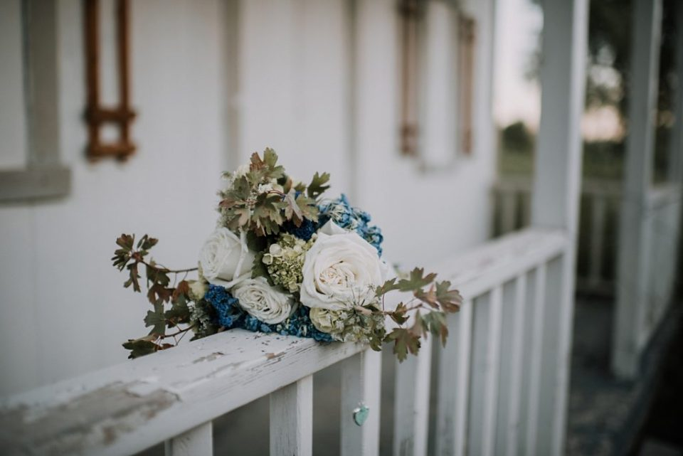 bridal bouquet on a rustic wood banister
