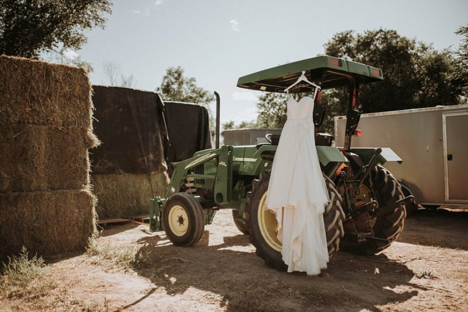 wedding dress on a tractor