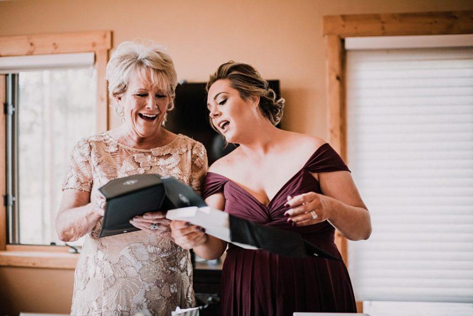 bridesmaids looking at brides boudoir album