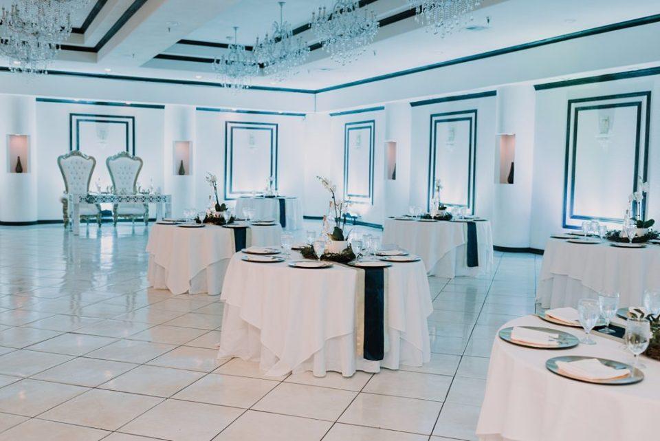 indoor wedding reception with blue up lighting