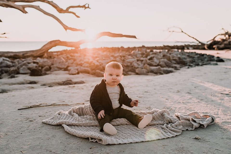 baby on a blanket at sunrise