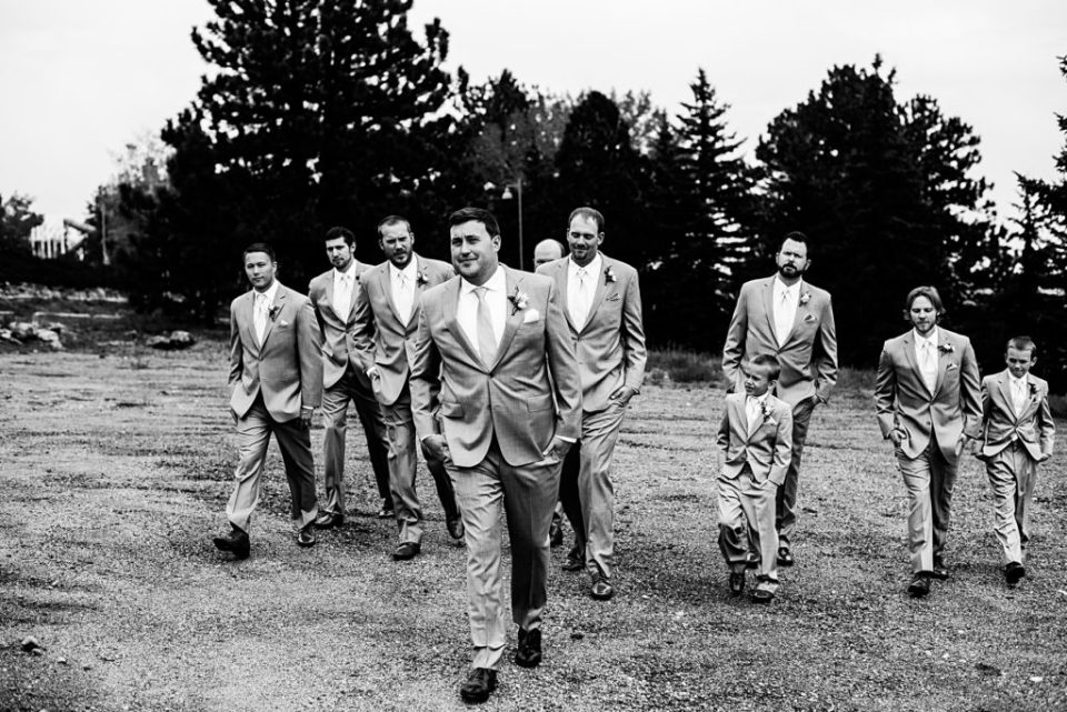black and white shot of groom party walking together