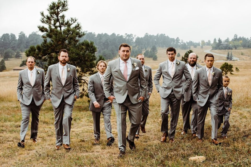 groom walking in front of his groomsmen