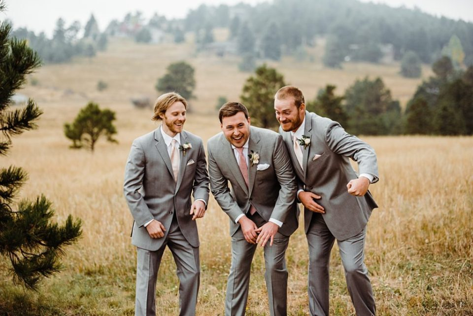 groom having fun with groomsmen