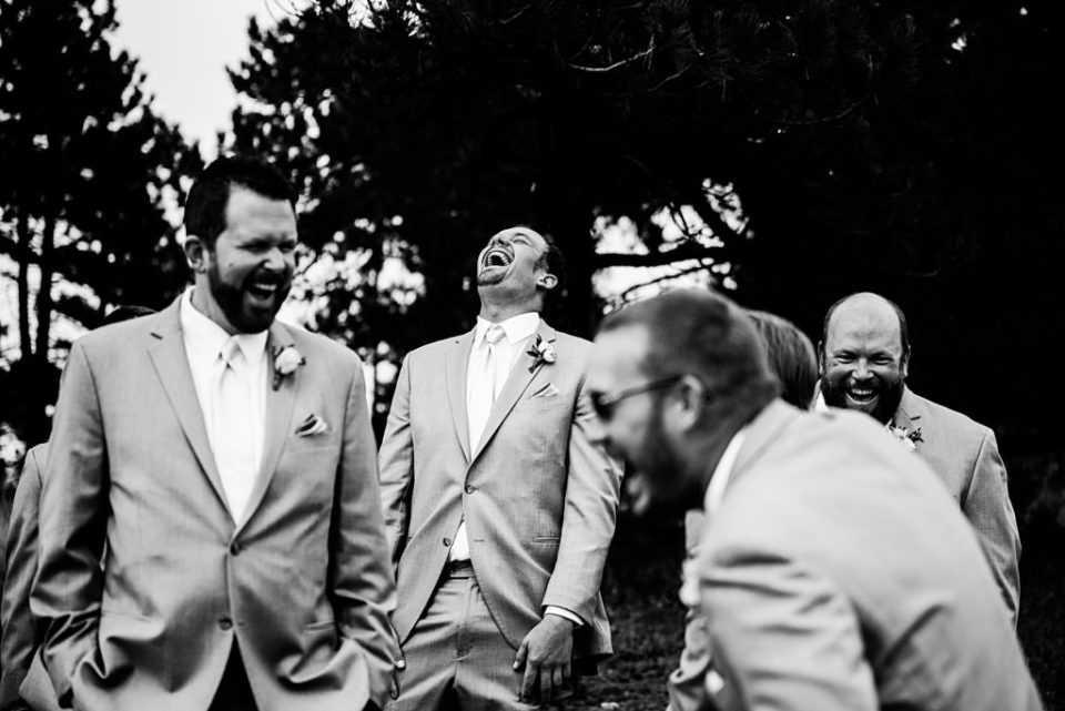 groomsmen laughing with head back
