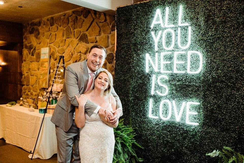 wedding couple with neon wedding sign