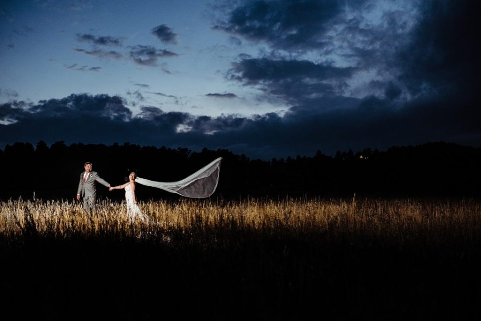 bride and groom with a dramatic veil using off camera flash