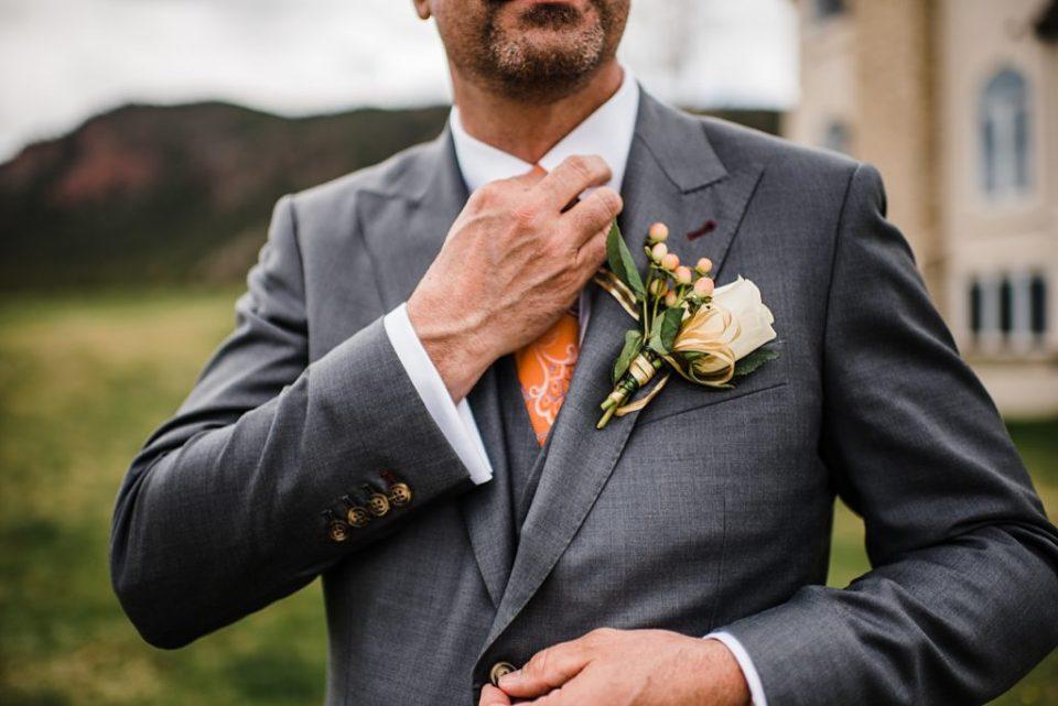 groom adjusting his tie