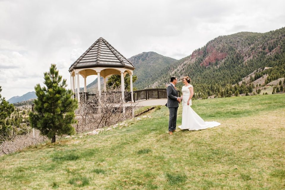 bride and groom with a gazebo