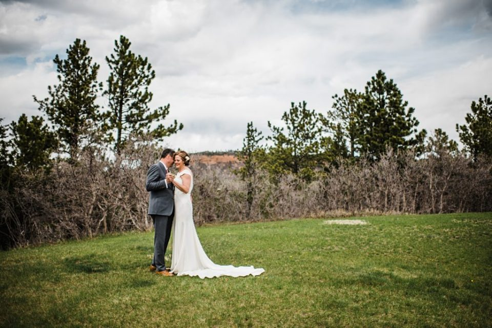 bride and groom dancing on the grass
