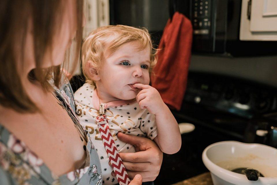 toddler tasting waffles