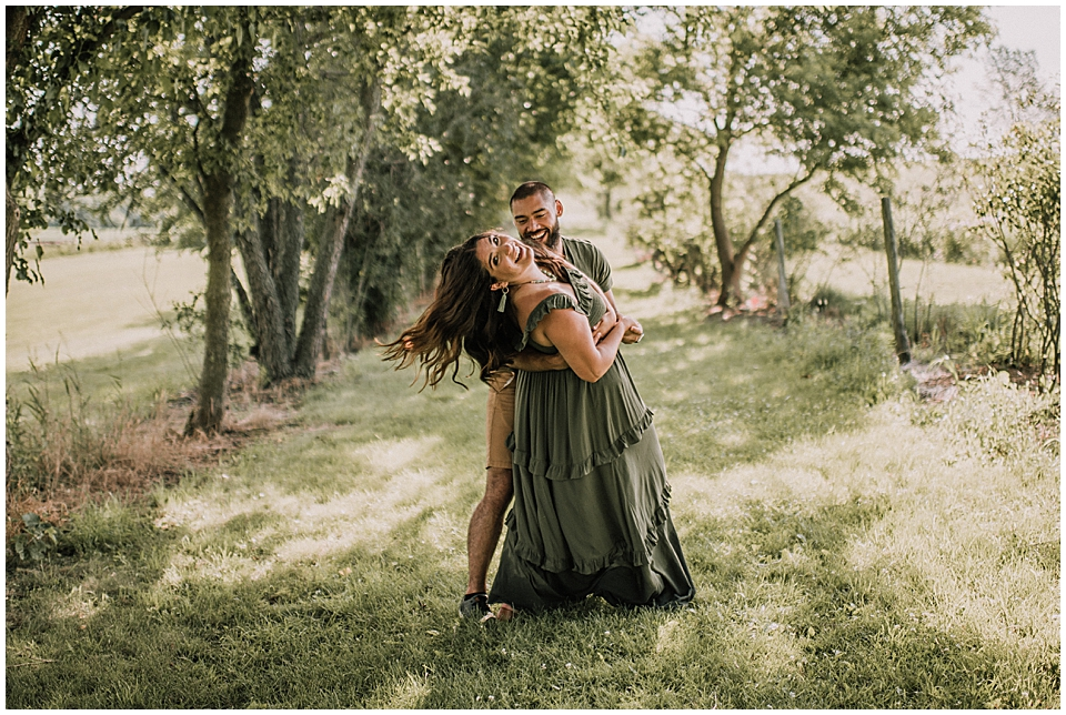 couple dancing in a grove of trees