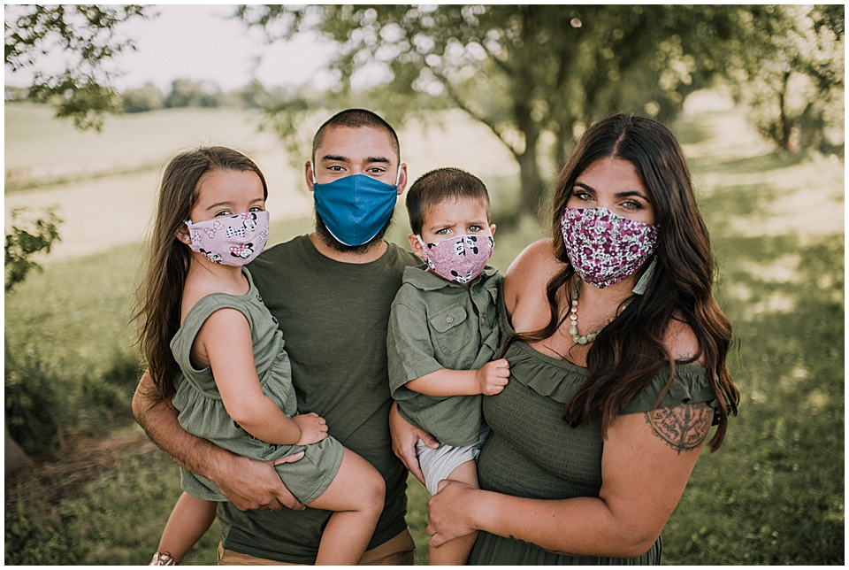 family of four wearing masks for family photos